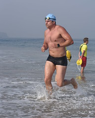 Broad Man in Nike Swim Trunks