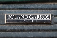 Roland Garros plate on an old Peugeot car