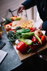Man preparing food in restauran Closeup of red and green peppers.