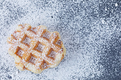 Round waffle with powdered sugar