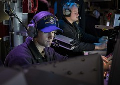 Lt. John Ondik acts as the officer of the deck during a combat systems training drill aboard USS Carney (DDG 64).