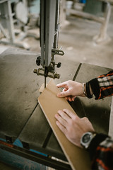Young man working on a rotary saw