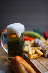 Homemade traditional Serbian sausage with a glass of cold refreshing beer.