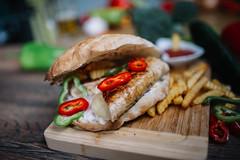 Grilled stuffed chicken steak in a sandwich