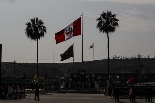 """Ceremonia por el 31 Aniversario de la Policía Nacional del Perú, llevada a cabo en la Escuela de Oficiales de la Policía Nacional del Perú, en el distrito de Chorrillos. Creada el 06 de diciembre de 1988, con la Ley 24949; la Policía Nacional del Perú agrupó en una sola fuerza policial las históricas Guardia Civil, Policía de Investigaciones y Guardia Republicana, siempre bajo el lema de """"Dios, Patria, Ley"""" y la misión garantizar, mantener y restablecer el orden interno."""