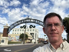 Paul at west gate to Ybor City, 7th Avenue, Tampa, Florida