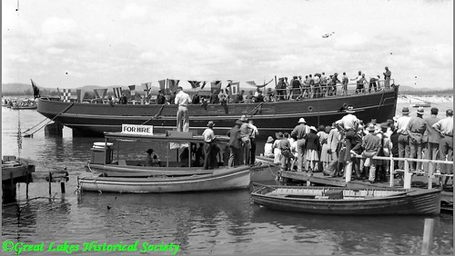 Newly launched tug 'Henry Miles' 1939 with launch 'Our Ivy' in foreground