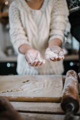 Closeup of female hand. hands in flour