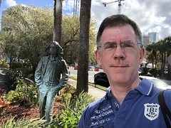 Paul with John Lennon statue, grounds of Barrymore Hotel, Tampa, Florida