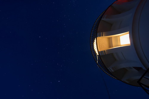 view of stars from under lighthouse