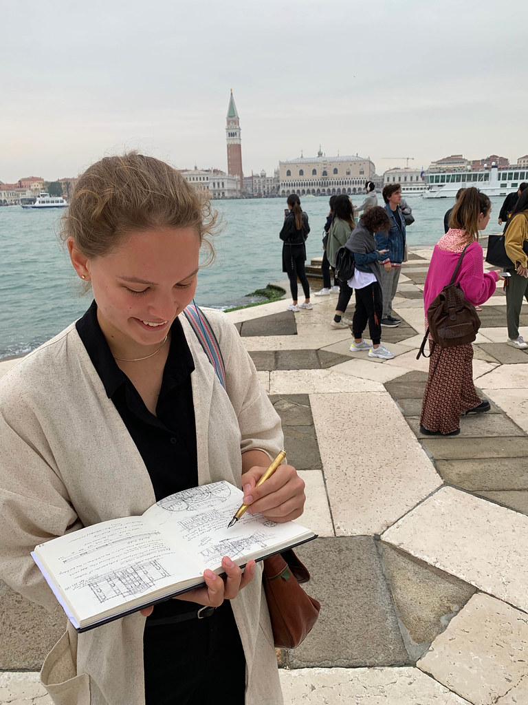 Gracie Meek (B.Arch. '22) sketches across the Grand Canal from Piazza San Marco in Venice.  photo / Abram Collette (B.Arch. '22)