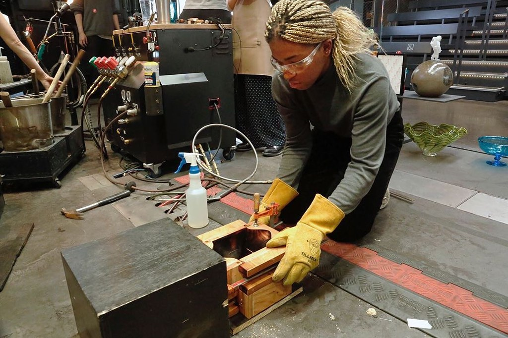 Students in the Coevolutionary Archetypes option studio, taught by Visiting Associate Professor Naomi Frangos, participated in the process of glassmaking at the Corning Museum of Glass.   Nwakoso Edozien (B.Arch. '20), sets up her wooden mold.