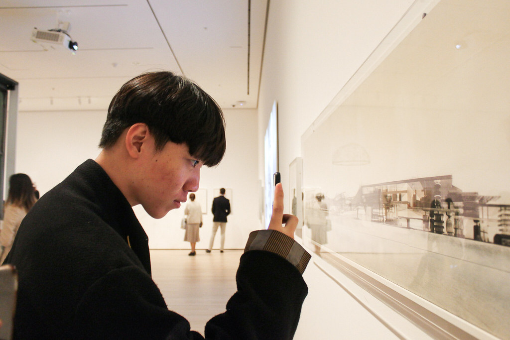 Jiarui (Bill) Zhang (B.Arch. '21) looks at a collage of Sector Models by Constant (Constant Anton Nieuwenhuys) at MoMA.   photo / Joyce Jin (B.Arch. '21)