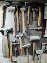 Collection of hammers in old car service