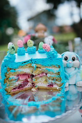 Half or slice of delicious fresh easter cake with bunny toy.