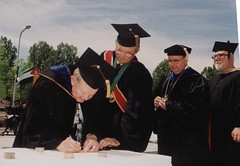 Parchment Signing for the Mace, Chancellor Emeriti Edward Weidner and David Outcalt, Chancellor Mark Perkins, and Faculty Member, David Damkoehler (designer of mace), June 2001