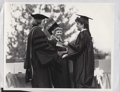 Betty Baer and Sally Mancoske awarding diploma, Commencement, May 1990