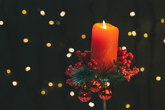 Christmas background with burning red candles and bokeh
