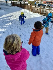 The twins are amazed that even very small kids are geared up to ski