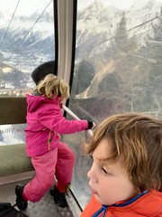 The twins are amazed at the views of the Alps around us as we head higher in the gondola