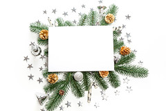 Christmas decor and tree branches background with free space in the middle