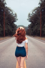 Woman standing on road - Credit to https://homegets.com/