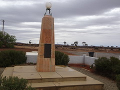 Manna Hill. The fine marble War Memorial for both World War One and World War Two.  Beyond is the Indian Pacific railway line.