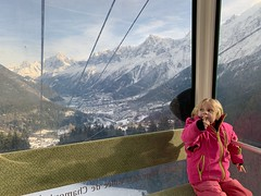 Madeleine sits in our gondola in front of some of the most famous peaks in Europe