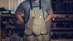 Photo of man wearing gray shirt and apron - Credit to https://homegets.com/