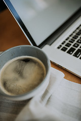 Workspace of stylish woman. Closeup of coffee and notebook