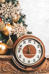 Vintage clock on background Christmas tree