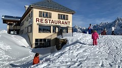 The twins walk to the restaurant at the top of the Prarion, with a great view of Mont Blanc
