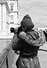 Woman Photographer capturing a Lisbon architecture detail