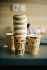 Empty paper cups for coffee in the kitchen. Ready for the party.