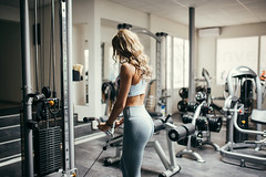Attractive blone woman working out in the gym