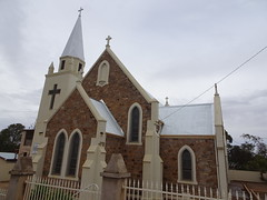 North Broken Hill. Murton Street. The 1929 built St Peter and St Paul Catholic Church. The adjacent Catholic School now vacant and vandalised.A site of child abuse.