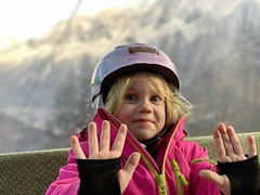 Madeleine having fun on the gondola to go up in the Alps and ski