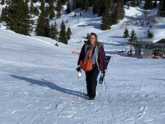 Kate carries the twins' skis for their first real day of skiing in the Alps