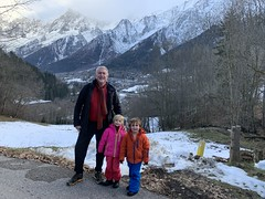 The twins and pose in front of the French Alps