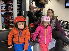 The twins get outfitted for another serious day of skiing, which they've become quite good at