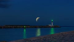 Phare et vert et lune