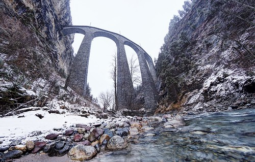 Ice cold water under a tall bridge