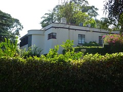 Mitcham. Adelaide.A European style modern home built in Church Street in 1937.  Art Deco features included the rounded glass brick two storey widow for the internal staircase.  Parapet hides the terracotta tiled roof. But where is Poirot.