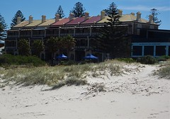 Adelaide. Grange Beach. The Marines terrace houses right on the beach and esplanade. These 8 three storey houses built in 1883. The proposed 13 others were never built.