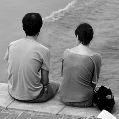 Calm couple observing Tagus River
