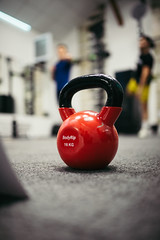 Red kettlebells weighing 16 kilograms