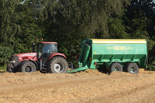 Case IH Magnum 335 Tractor with a Hawe Chaser Bin
