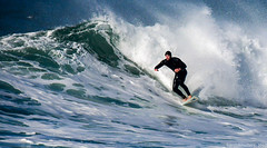 Surfer catching the large waves