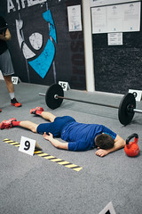 Man resting after the workout in the gym