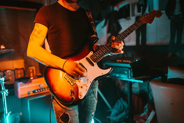 Photo:Closeup of guitar player live at club By shixart1985